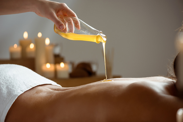 Cookie Studio/Shutterstock.com (Honey pouring on girl's naked back in spa salon.)